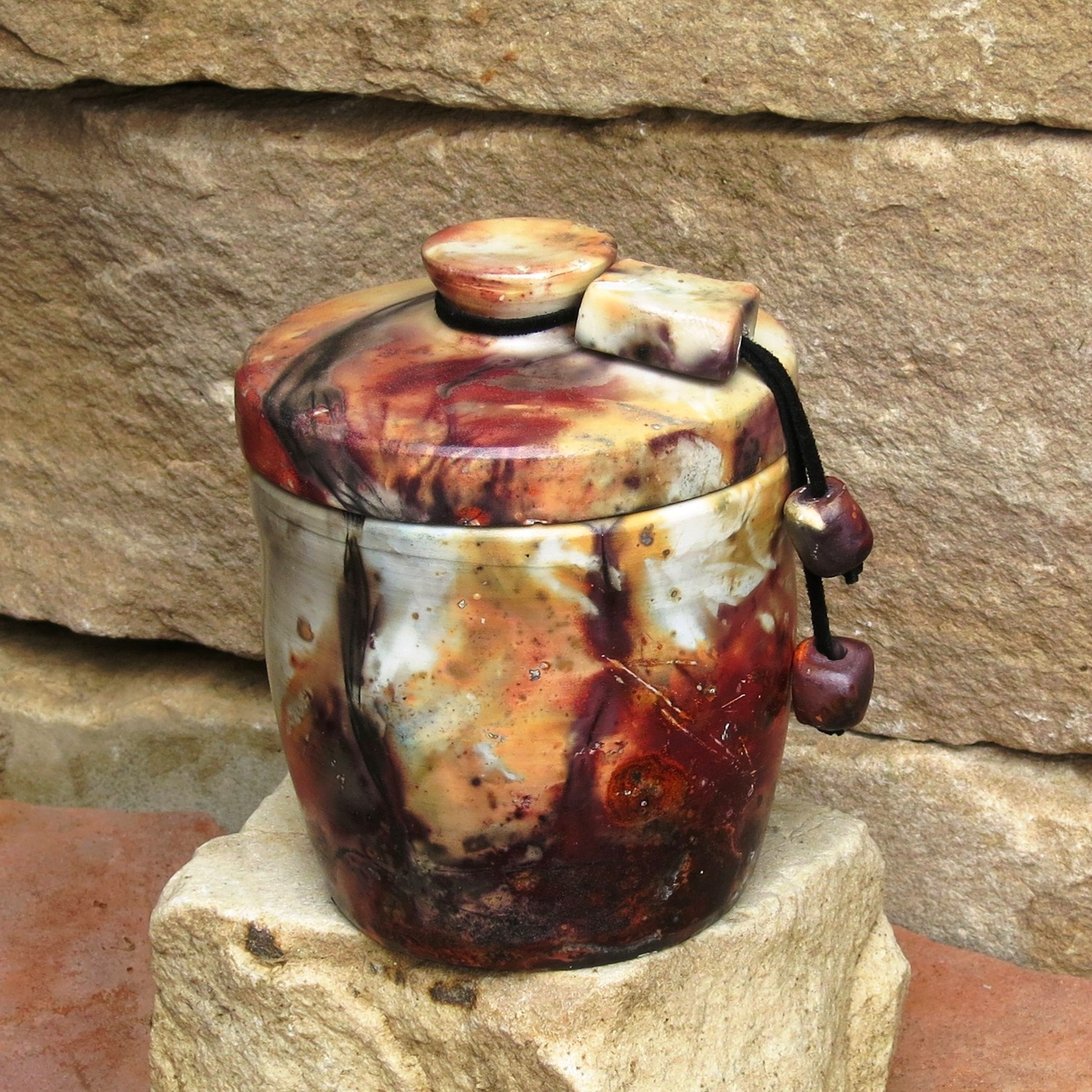 Maroon lidded with beads.jpg