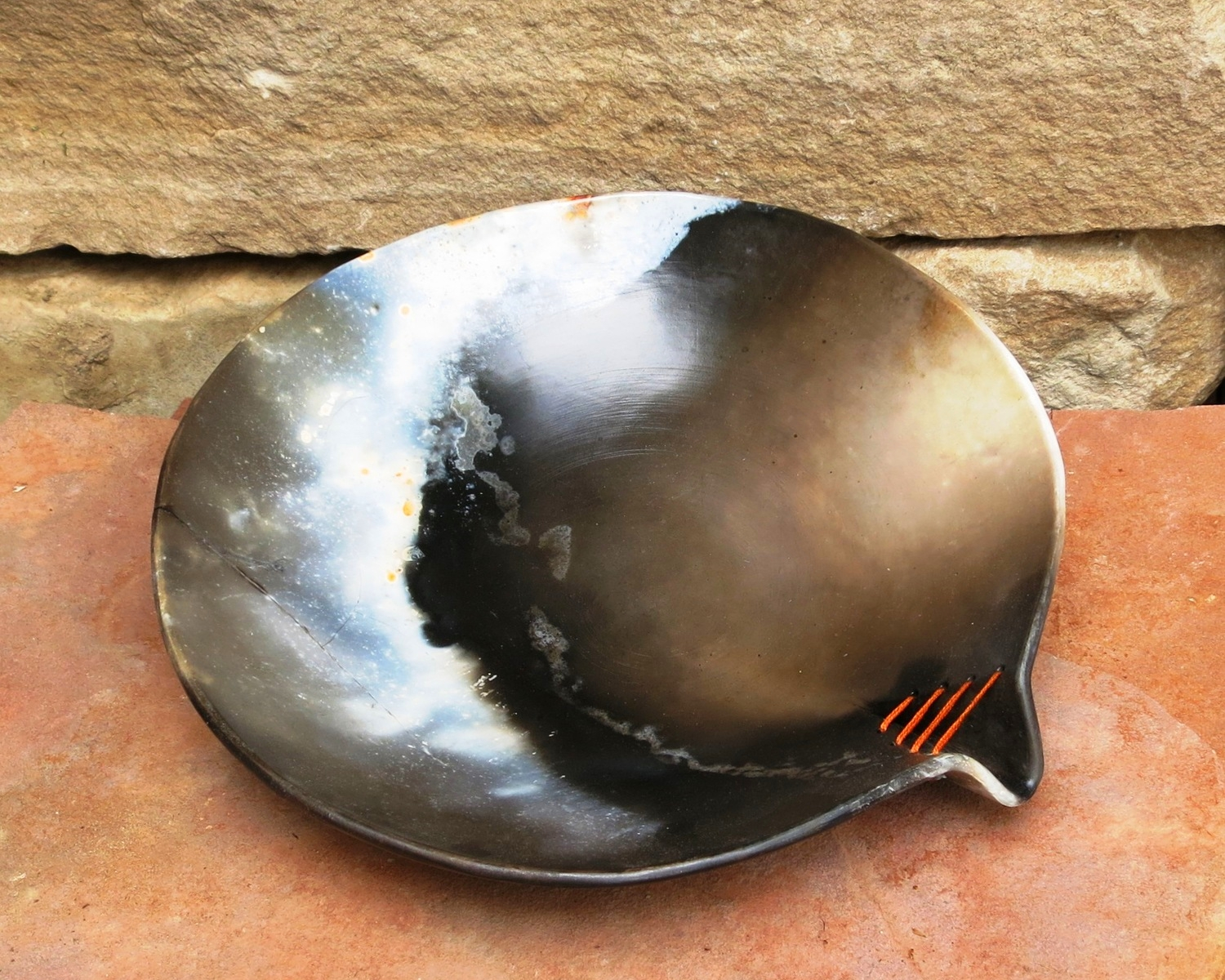 universe orange stitch bowl.jpg