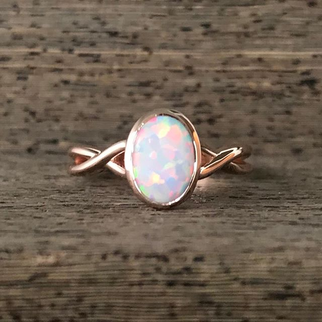 How sweet is this rose gold opal ring!? 💕  #rosegold #opal #bezelsetting #rogersandco #rogersandcofinejewelry #missoula #customjeweler #montanabride #twistrings