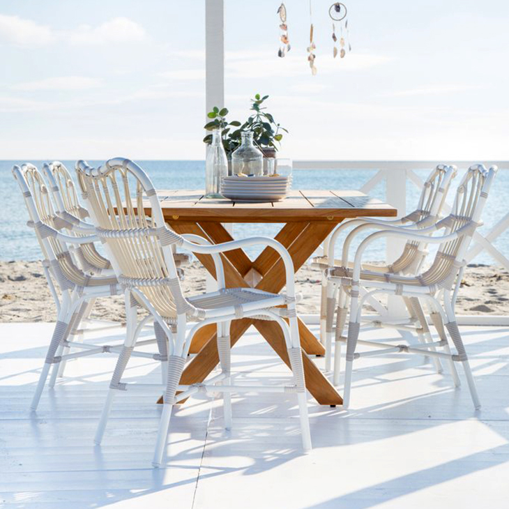 NEW Teak Dining Table Collection   Chic teak.   Click to shop this collection.