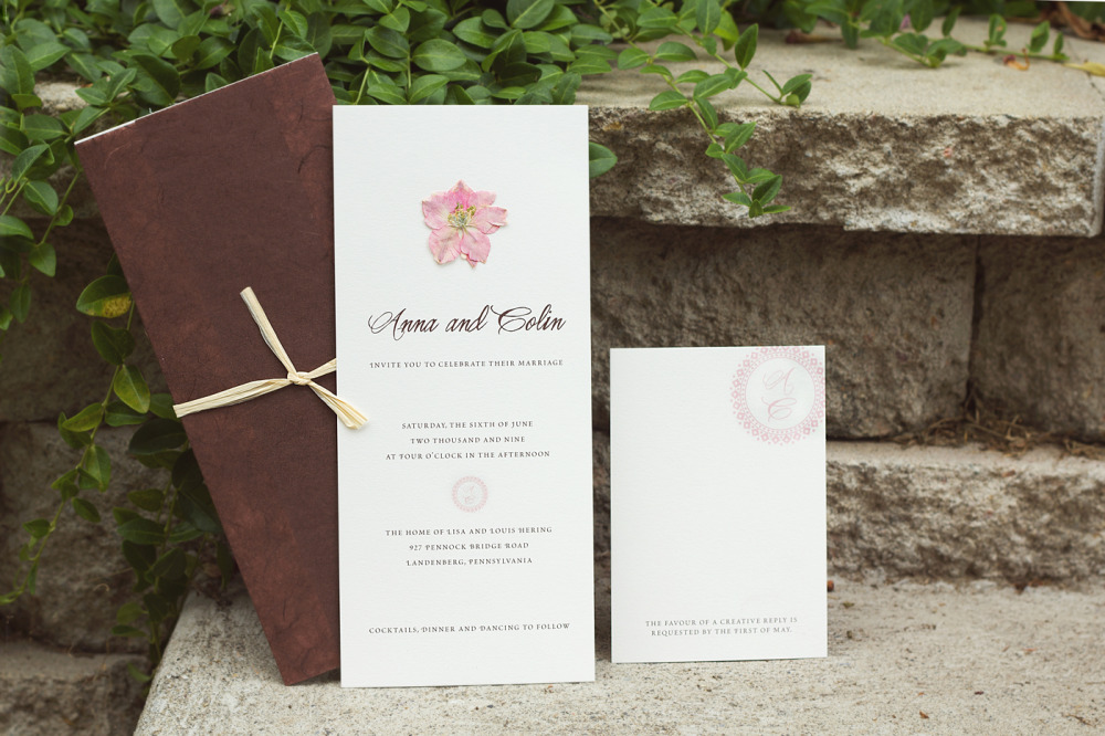 Anna and Colin   Special Design Notes:  Real pressed flowers adhered to invitation; invitation wrapped in rice paper and tied with raffia  Printing Method:  Offset  Paper:  Strathmore 110# coverstock