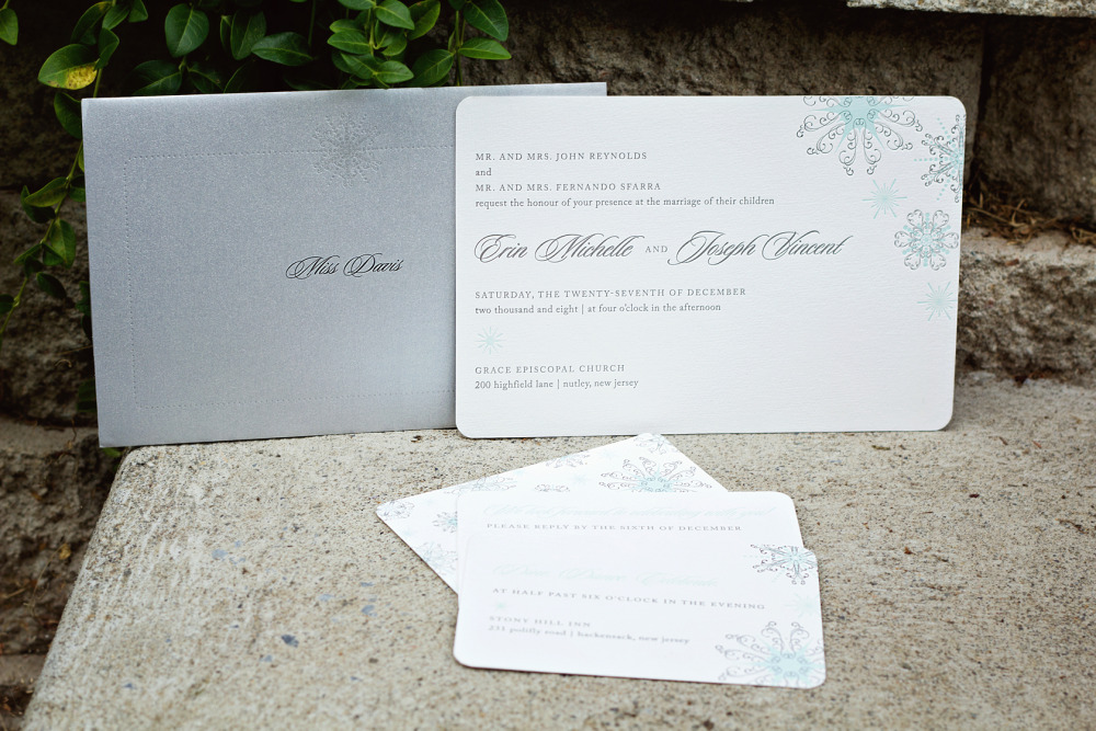 Erin and Joseph   Special Notes:  Erin and Joseph's winter wedding featured a silver wrap with each guest's name personalized on the cover; the invitation and enclosures were printed front and back with the backs covered with a beautiful snowflake pattern  Printing Method:  Letterpressed  Paper:  Hammermeuile (no longer available) *please inquire about new paper options