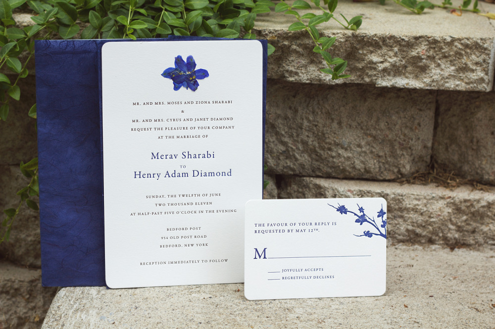 "Merav and Hank    Special Design Notes:   Real pressed flowers adhered to invitation; invitation wrapped in rice paper and tied with raffia   Printing Method:  Letterpressed  Paper:  Cranes  ""I just wanted to thank you once again for al your wonderful work & dedication to making the invites and menu as perfect as can be!""  —Merav and Hank, New York City"