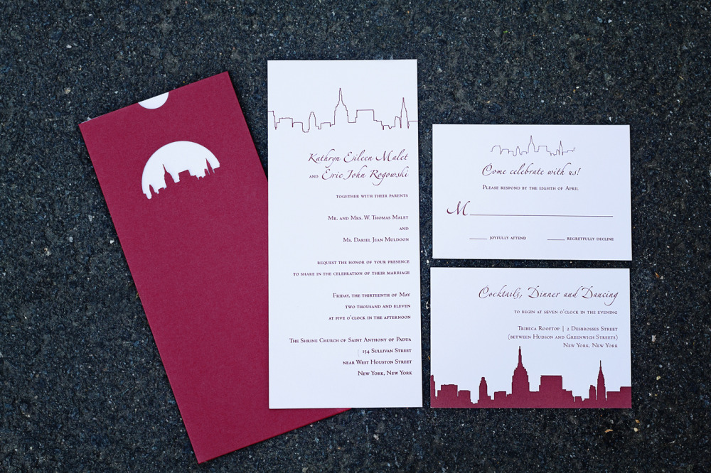 Kate and Eric   Special Design Notes:  Custom laser cut pocket of NYC skyline; invitations and enclosures all inserted into the holder   Printing Method: Letterpress (can be offset)  Paper: Cranes Lettra  As seen in: original design for Darlan and Frank featured in NewYorkMagazine.com, April 2008
