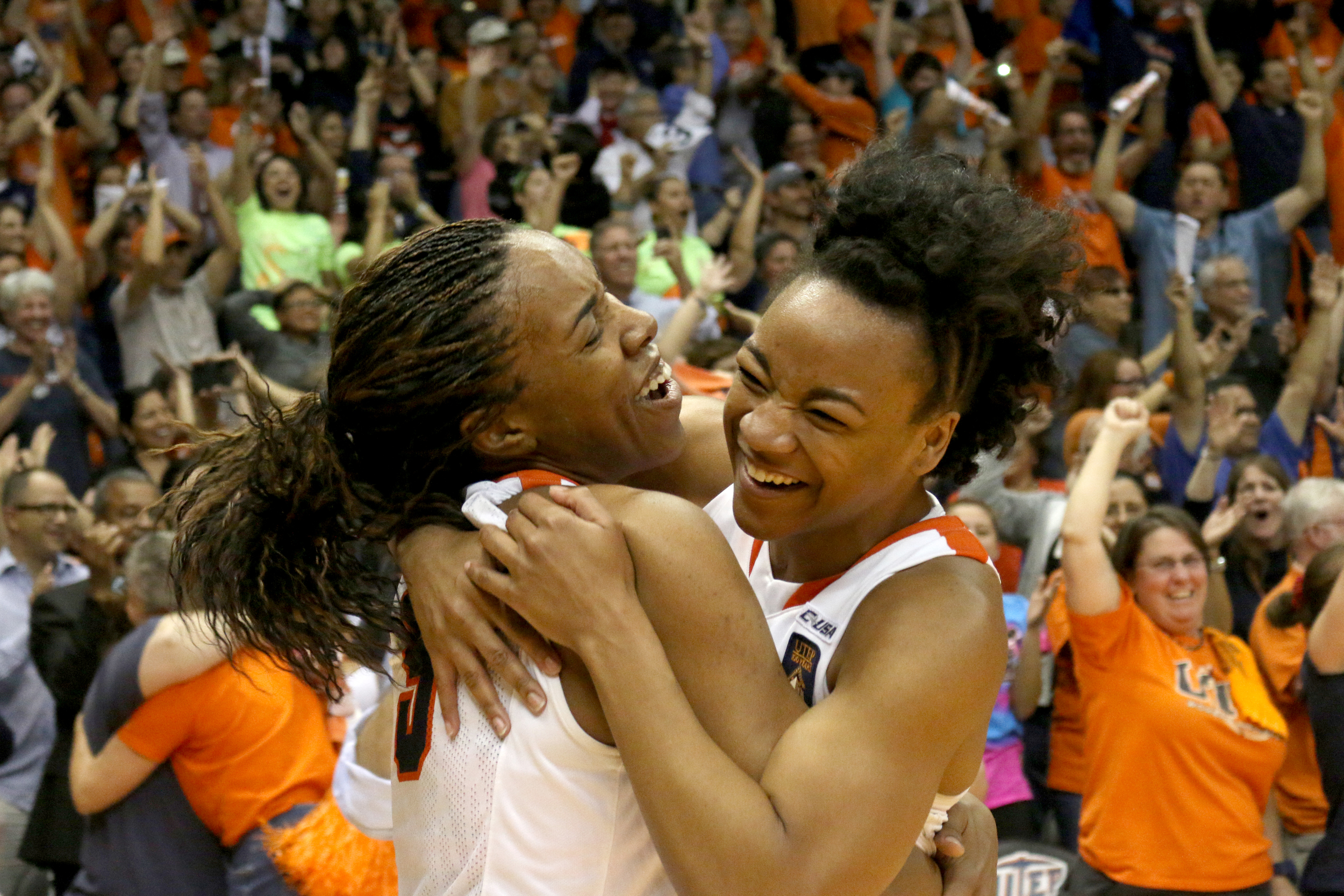 Senior forward Kayla Thornton and sophomore guard Jenzel Nash celebrate their win over South Dakota State, which advanced them to the 2014 WNIT championship game in El Paso, Texas on April 2, 2014.