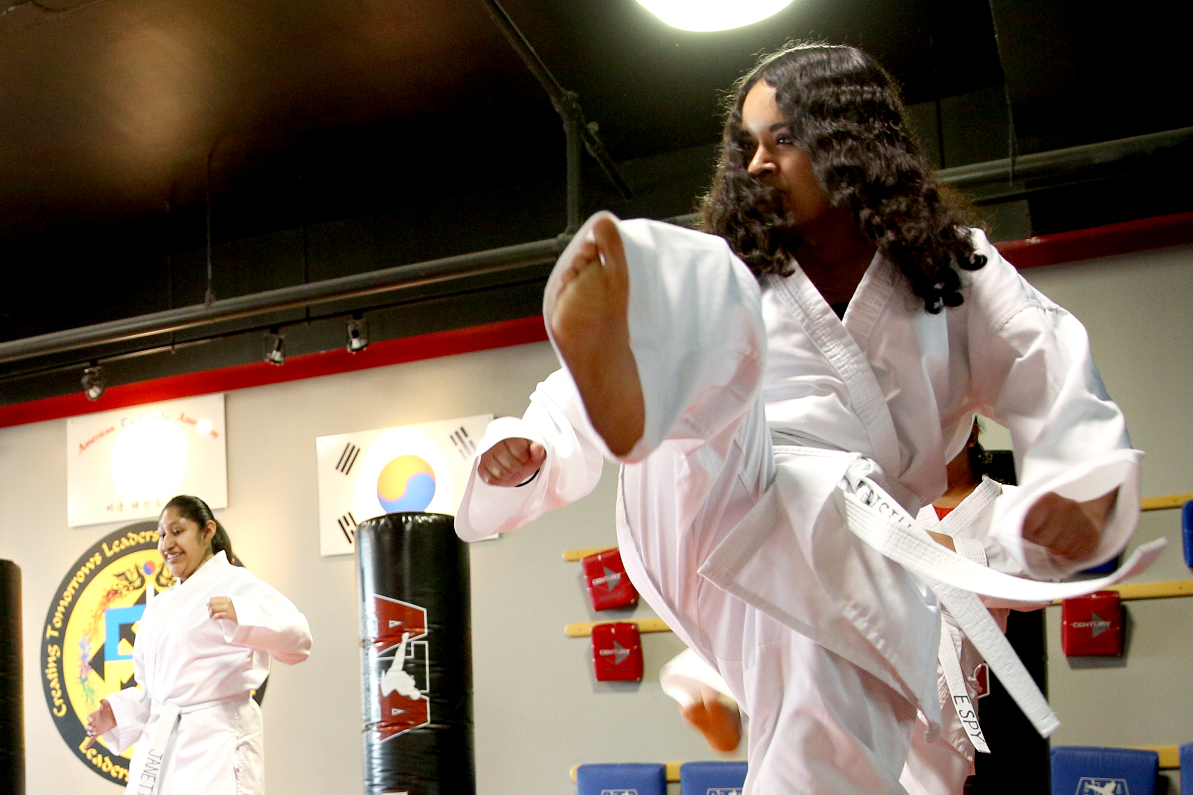 Prisilla Hernandez-Brado practices kicking as part of a Woodburn School District transition program at ATA Martial Arts Keizer on Thursday, Dec.13, 2018.