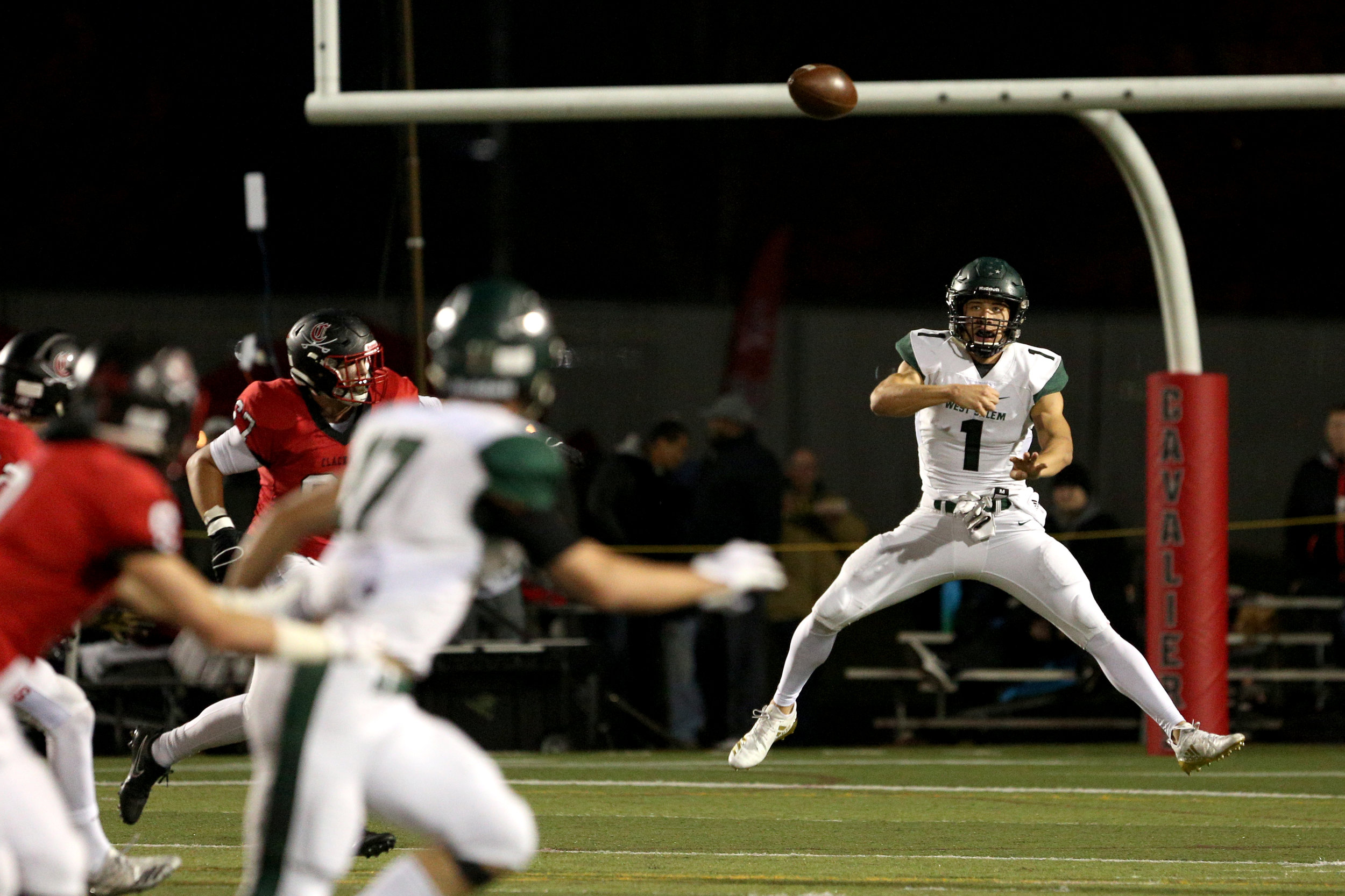 West Salem quarterback Simon Thompson makes a pass during the West Salem High School vs. Clackamas High School 6A playoff football game in Clackamas, Oregon on Friday, Nov. 9, 2018.