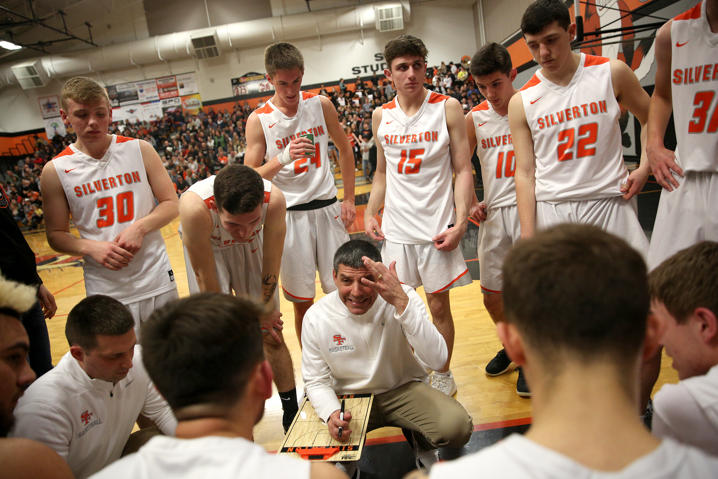 Head coach Jamie McCarty talks to his team at the bench during the Silverton vs. Springfield boys basketball OSAA state playoffs game at Silverton High School in Silverton, Oregon on Saturday, March 2, 2019.