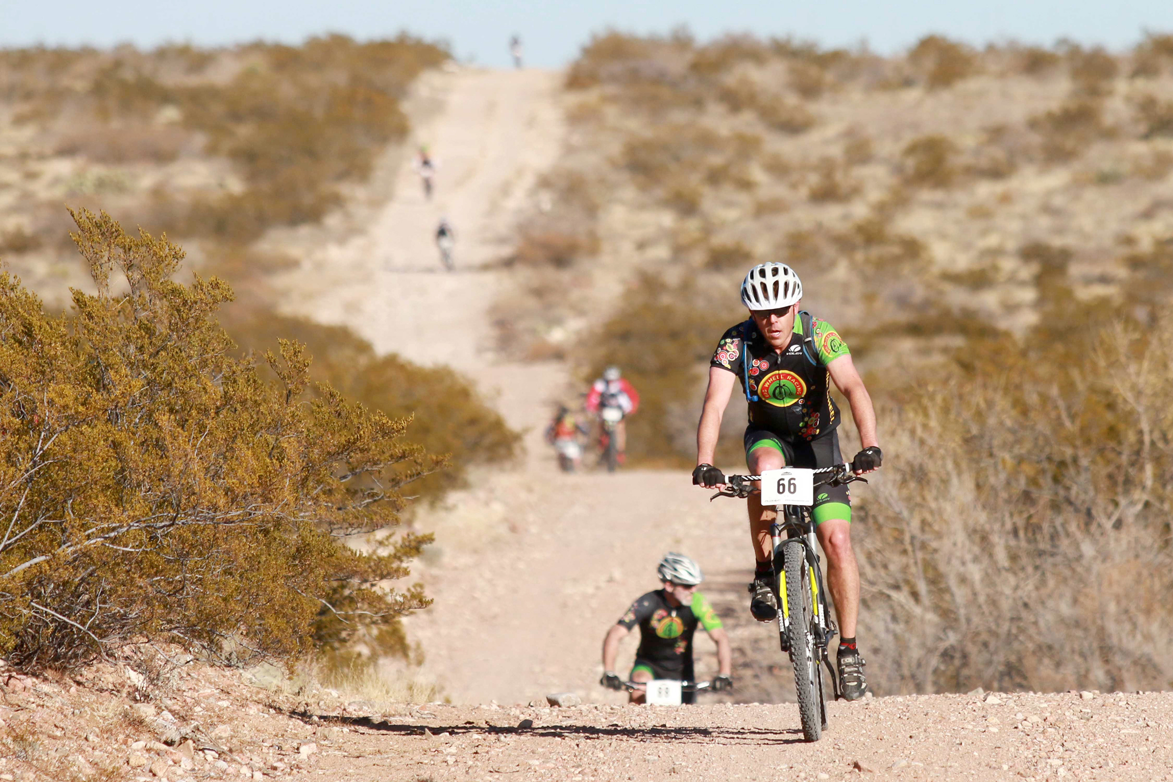 Cyclists participate in the 50-mile Puzzler Endurance Mountain Bike Race at Bowen Ranch in El Paso, Texas on January 18, 2015.