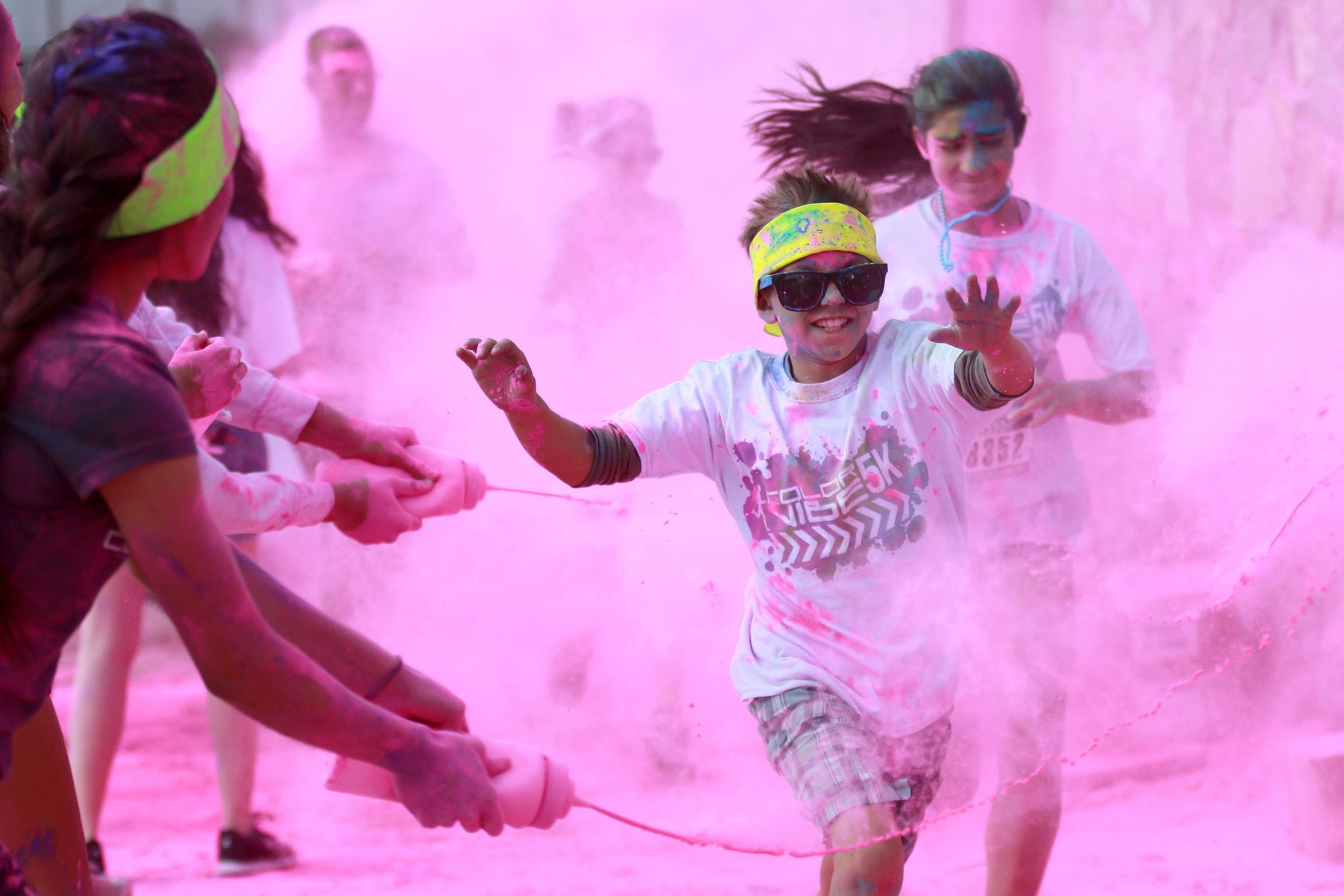 Participants of the Color Vibe 5K marathon are splashed with powdered paint at Ascarate Park in El Paso, Texas on Apr 4, 2015,