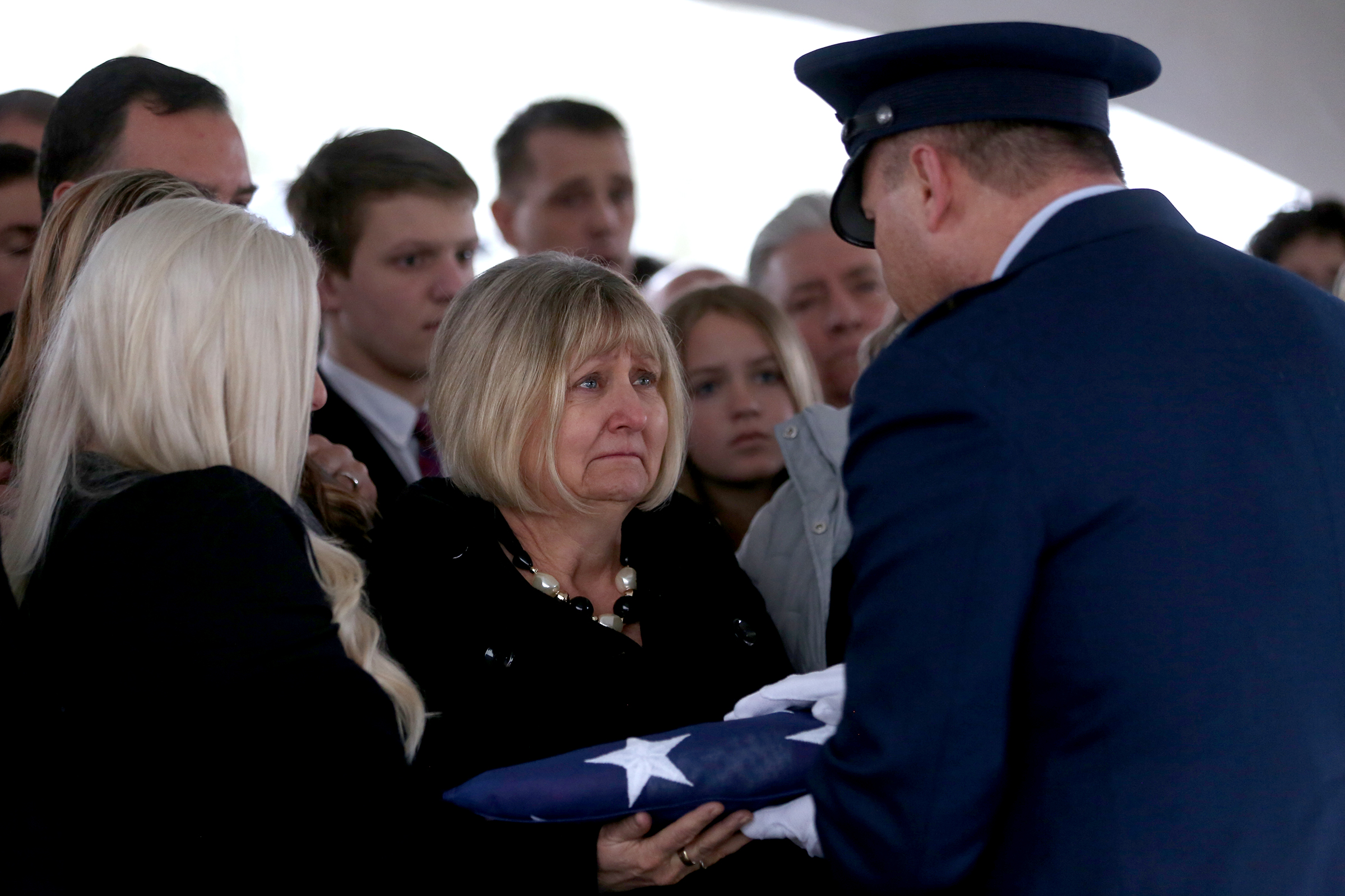 Cathy Richardson is presented with the flag following the state funeral for her husband, Secretary of State Dennis Richardson, at the Oregon State Capitol in Salem on Wednesday, March 6, 2019.