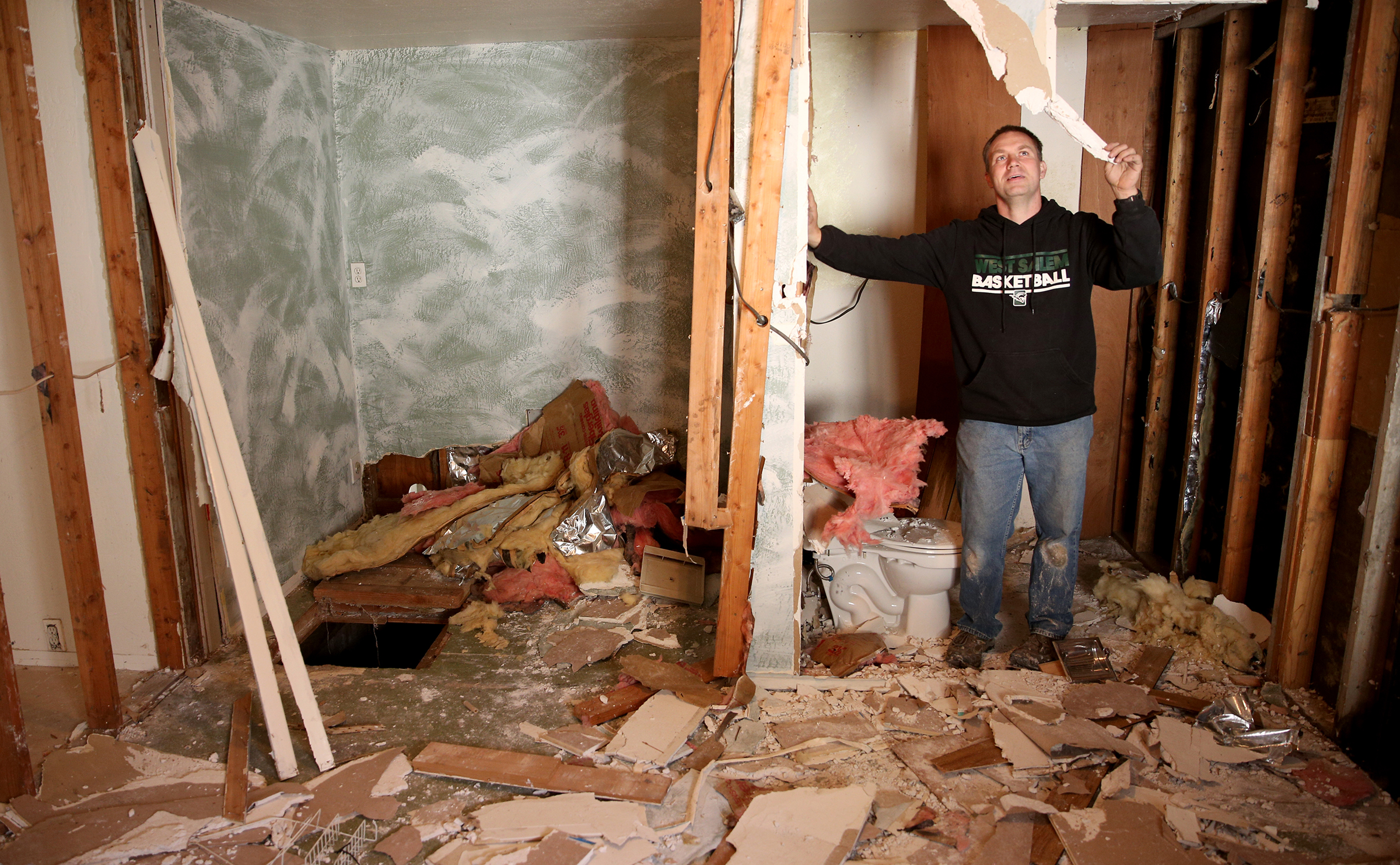 Travis Tubbs shows the last room in his home torn up, on Thursday, Nov. 15, 2018, in Jefferson. The family purchased the property last year and found it was contaminated with meth.