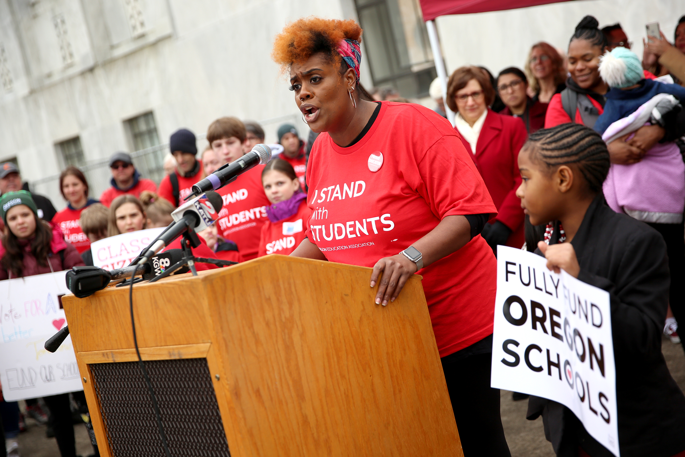 Portland fourth grade teacher Nichole Watson speaks before supporters from across the state marched around the Oregon State Capitol in support of public education on Monday, Feb. 18, 2019.