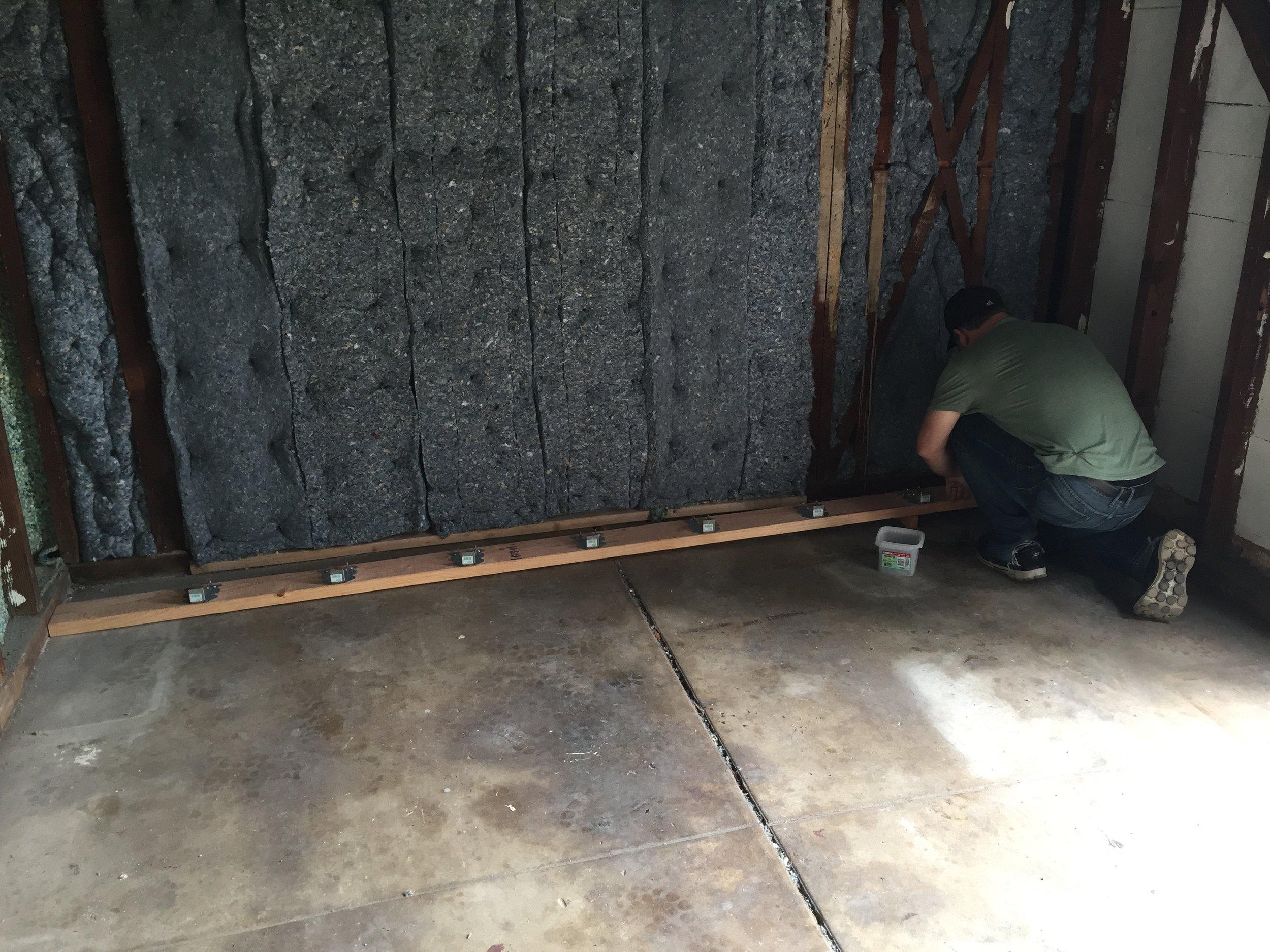 Installing hangers for the new floor joists