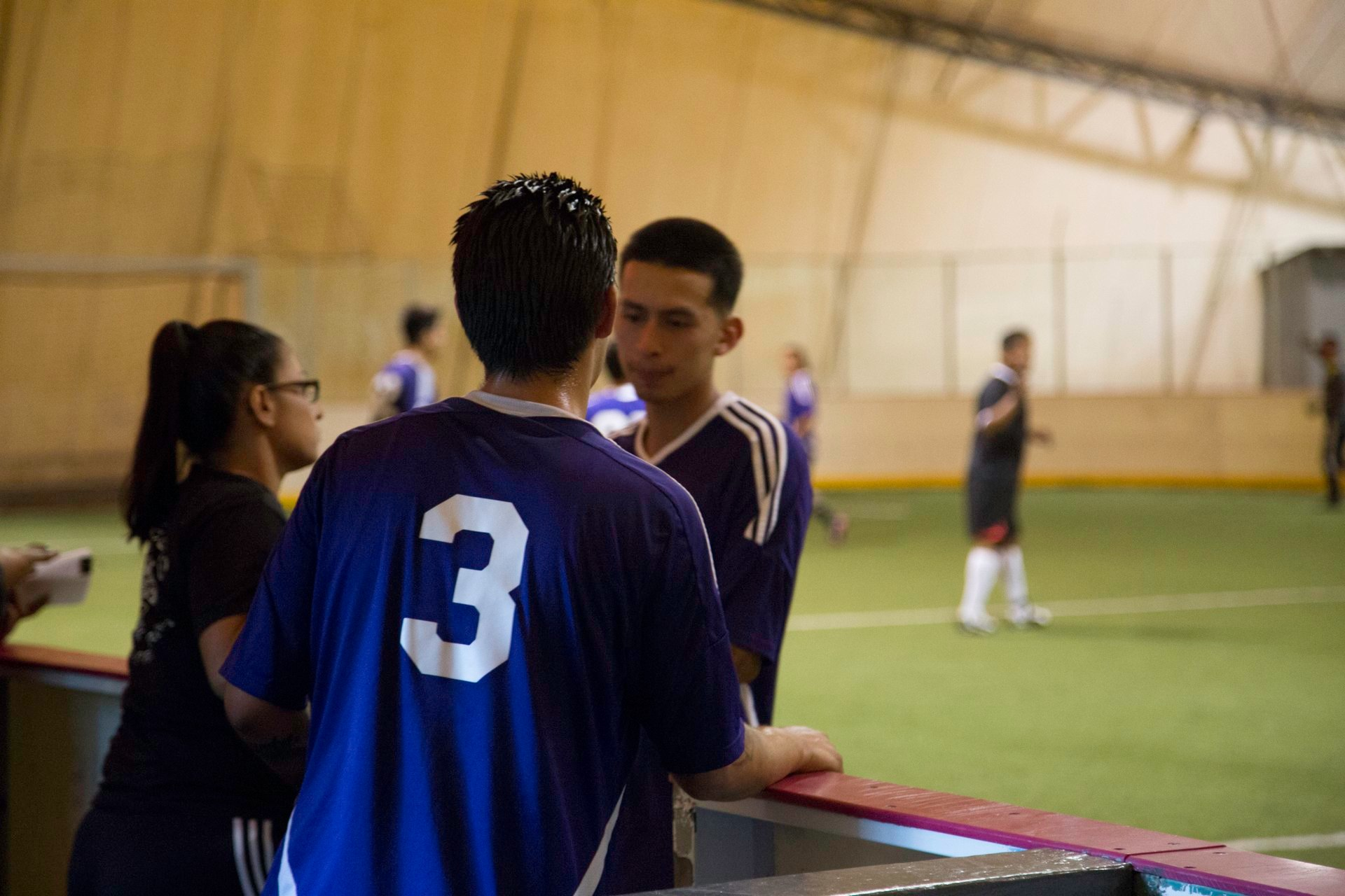Gina coaching the Aztecas youth soccer players.