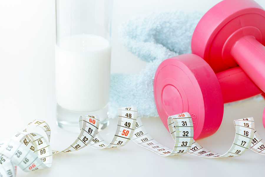 Getting ready to exercise barbell tape measure protein shake