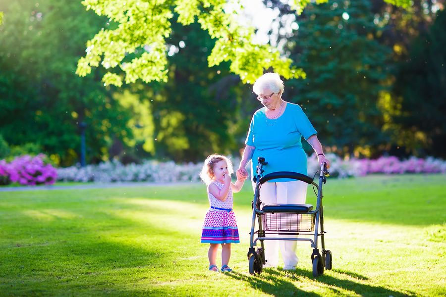 senior-lady-mobility-aid-granddaughter