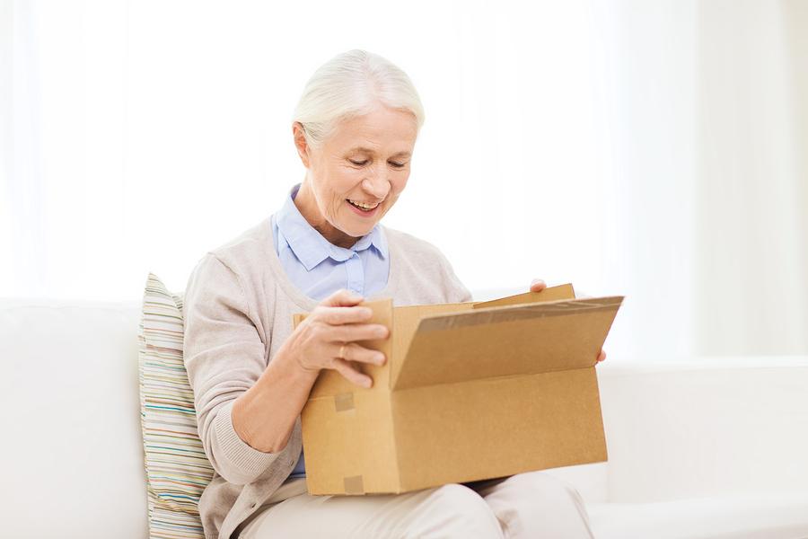 lady-opens-prescription-home-delivery-parcel
