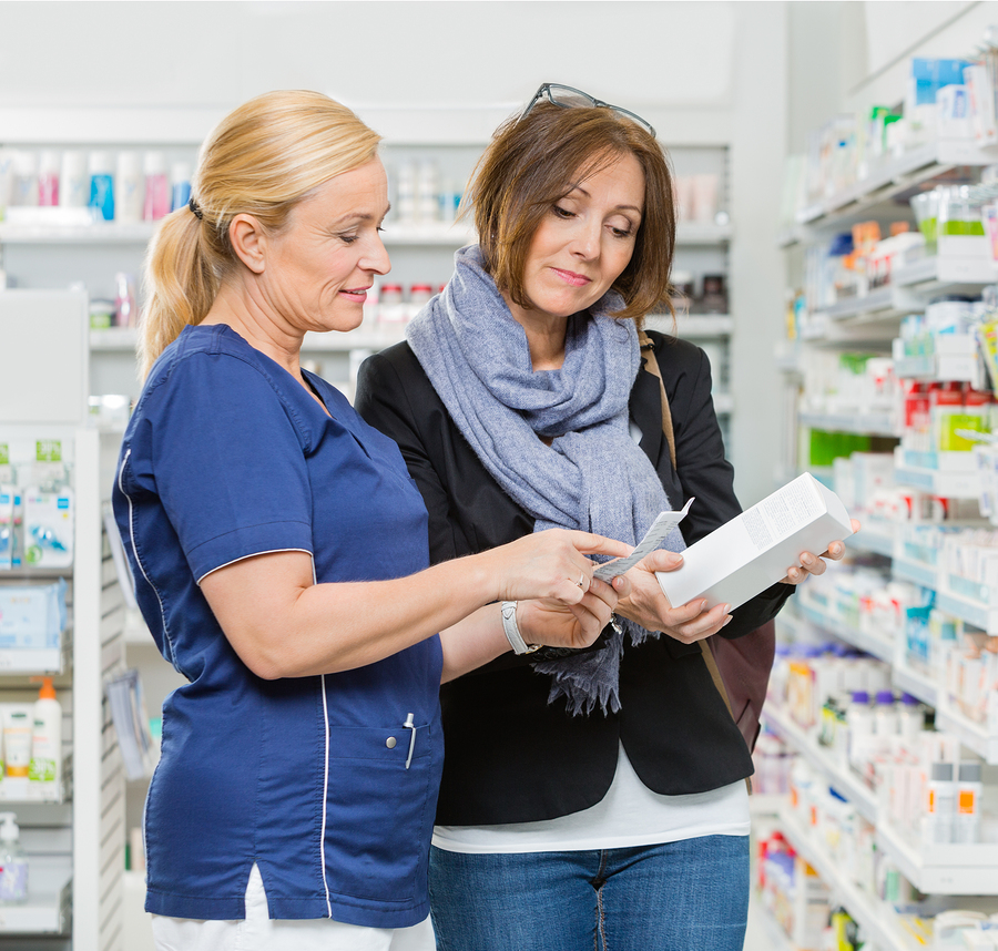 Pharmacist explaining to woman