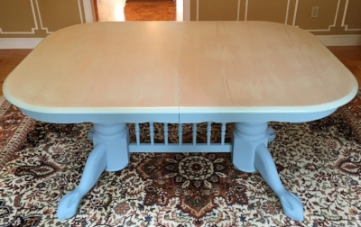 The dining table previously painted