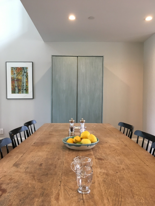 The armoire with the dining table in front
