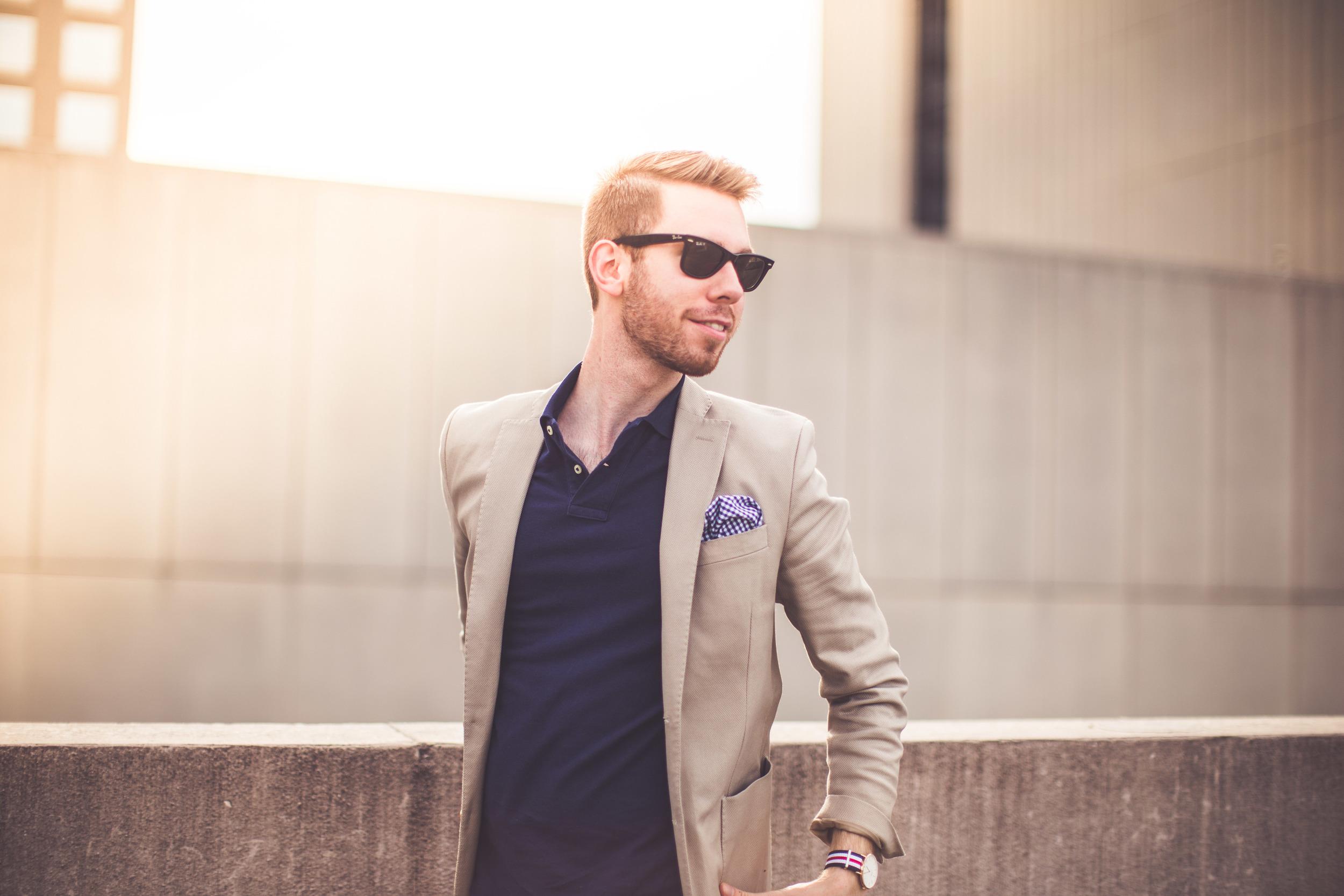 Shirt: Ralph Lauren, Blazer: J. Lindeberg, Pocket Square: J Crew, Sunglasses: Ray-Ban, Watch: Daniel Wellington