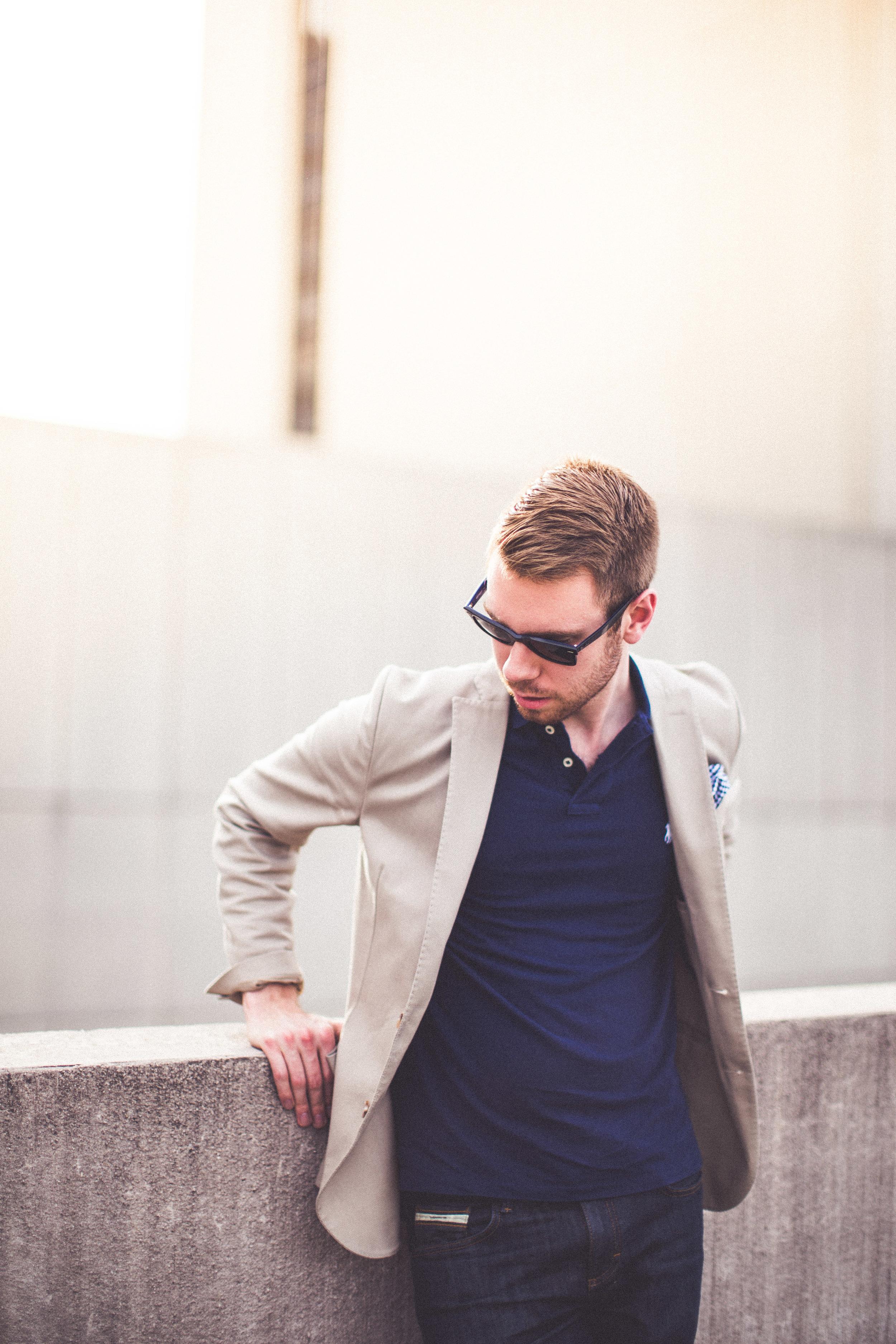Shirt: Ralph Lauren, Blazer: J. Jindeberg, Pocket Square: J Crew, Sunglasses: Ray-Ban, Watch: Daniel Wellington, Jeans: Vans