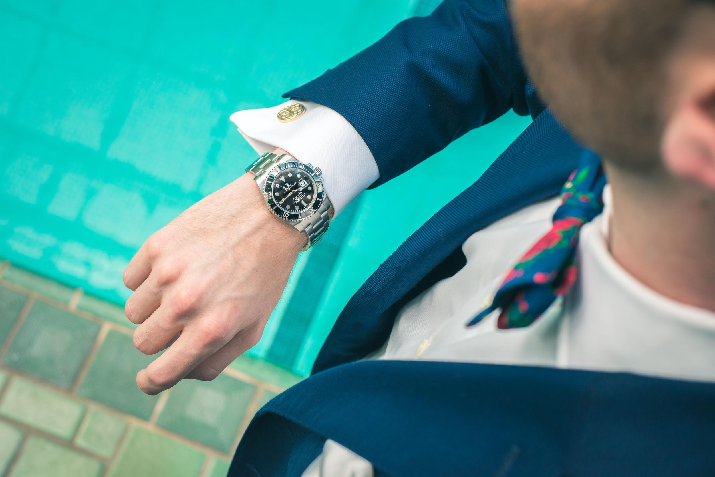 Watch: Rolex, Shirt: Ledbury, Suit: J. Lindeburg, Tie: The Tie Bar, Photo: Alec Hutchins Photography, Model: Noah Williams, Location: Reynolda House Museum of American Art historic indoor pool.