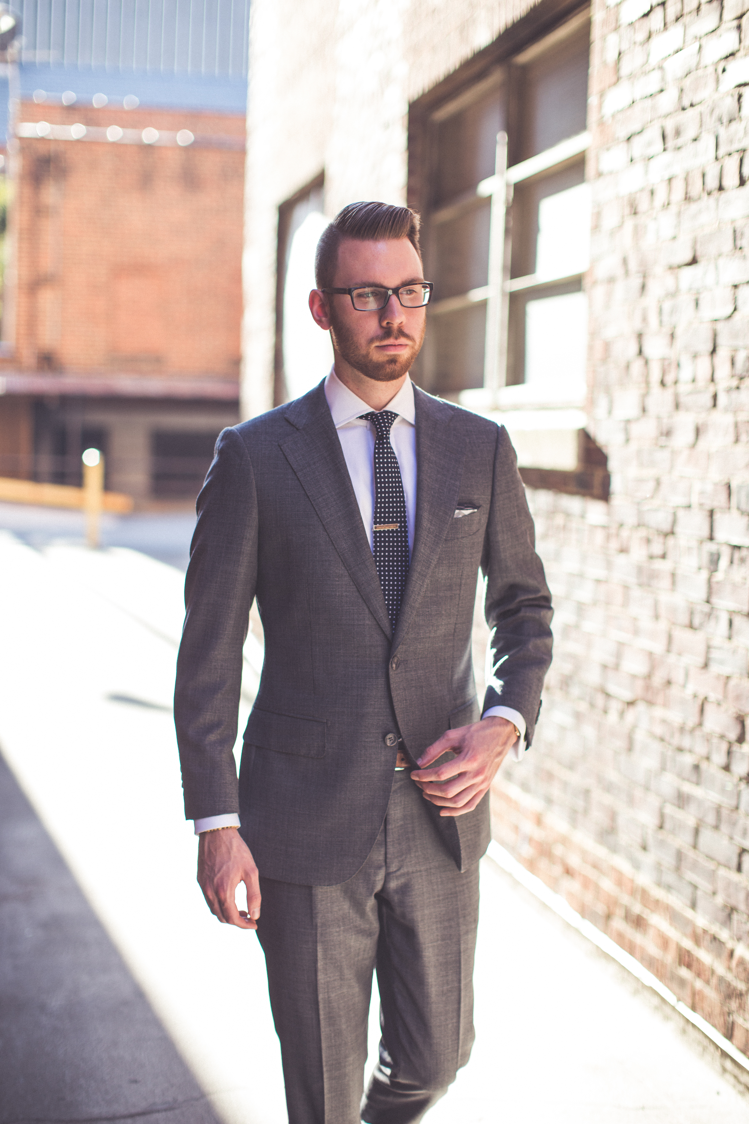 Suit: Suit Supply, Shirt: Ledbury, Tie/Pocket square: Sprezza Box, Tie-bar: The Tie Bar, Glasses: Burberry.