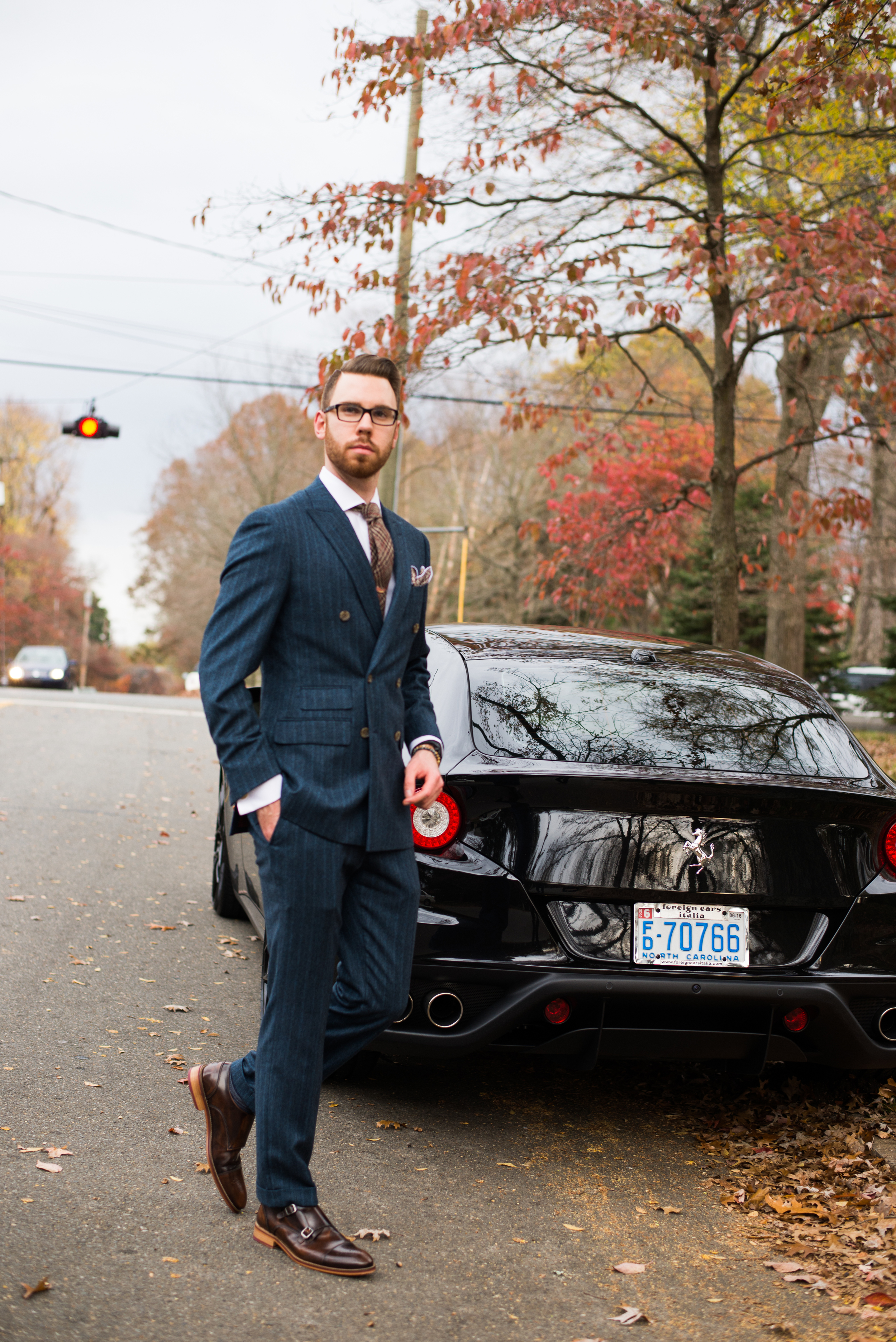 Suit: Indochino, Shoes: Johnston & Murphy, Glasses: Burberry, Watch: Snyper, Shirt: Ledbury, Tie/Pocket Square: Sprezza Box, Car: Ferrari FF, Photo by Alec Hutchins Photography, Hair styled by: Carlos Carvana; Owner The Oval Office.