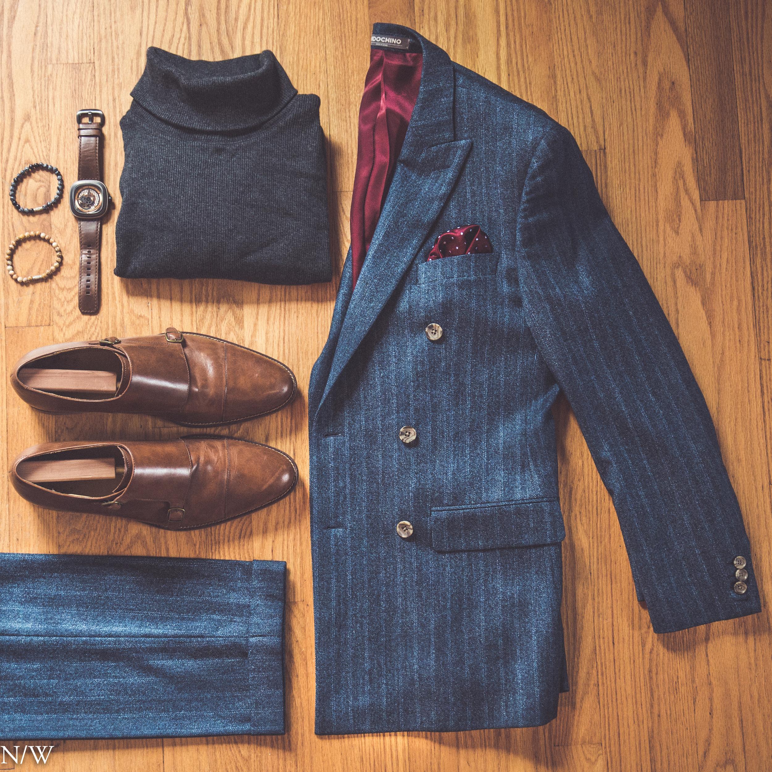 Suit: Indochino, Shoes: Cole Haan, Sweater: Ralph Lauren, Watch: Seven Friday, Bracelets: Our Saints, Pocket Square: Bows-n-ties.com.