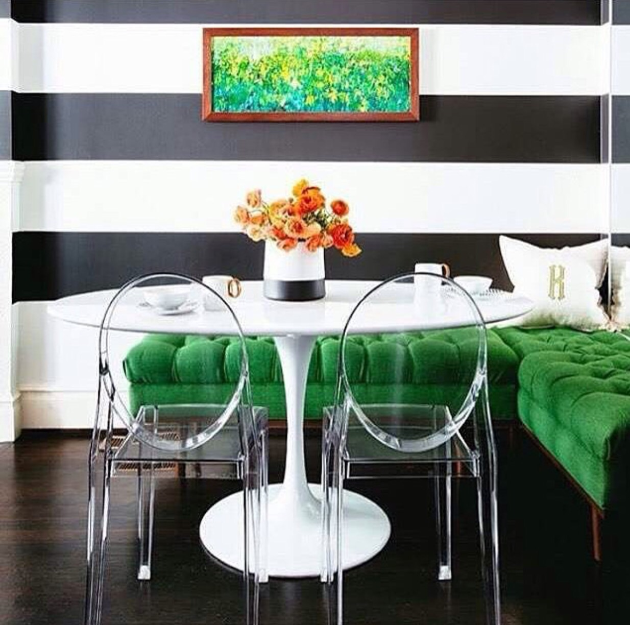 This upholstered bench acts as a bold statement piece in this informal banquette dining area.