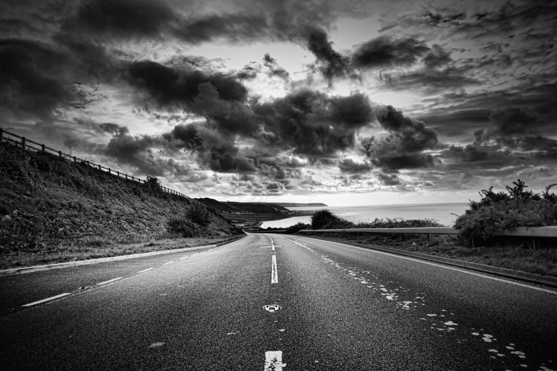 a_road_winds_off_into_the_distance_black_and_white_by_macinivnw-d68ojzo.jpg
