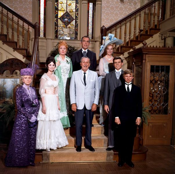 The cast of  The Happiest Millionaire  surround Walt Disney.