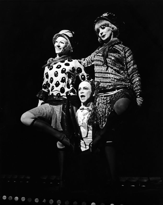 "Mary Ehara, Joel Grey and Rita O'Connor perform ""Two Ladies"" in  Cabaret ."