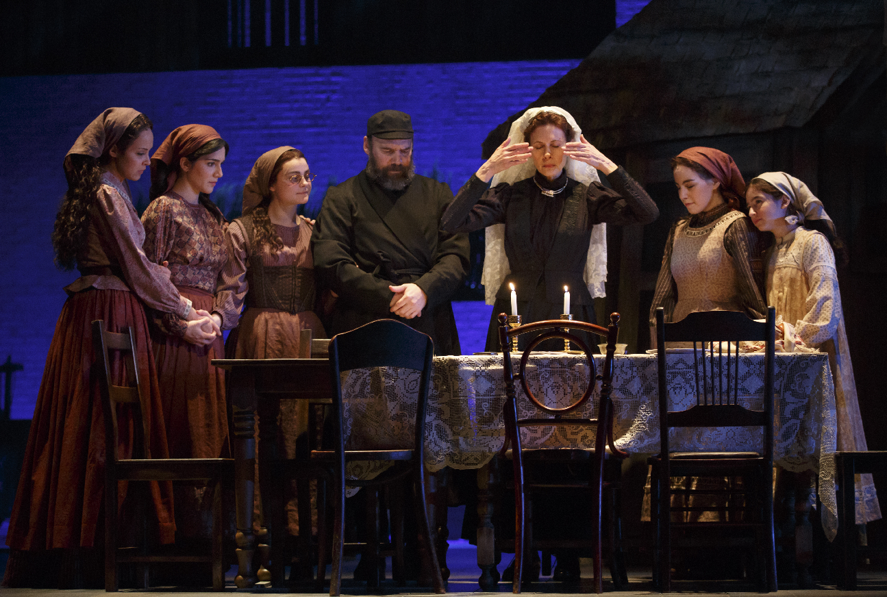Danny Burstein and Jessica Hecht surrounded by the daughters of  Fiddler on the Roof .