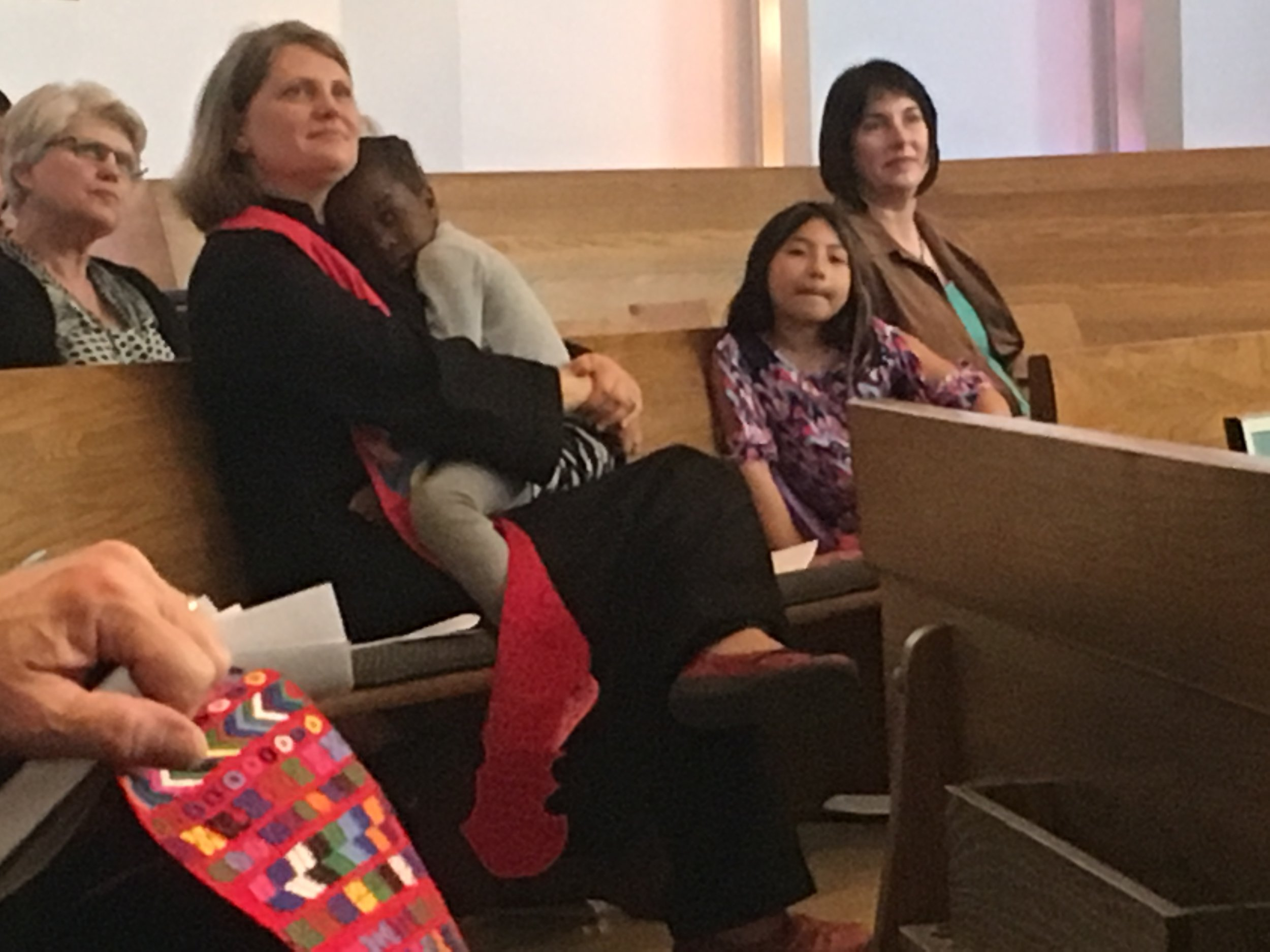 Rev. Hanna with her daughter Vivienne and Rebecca Souza with her daughter Lacey.