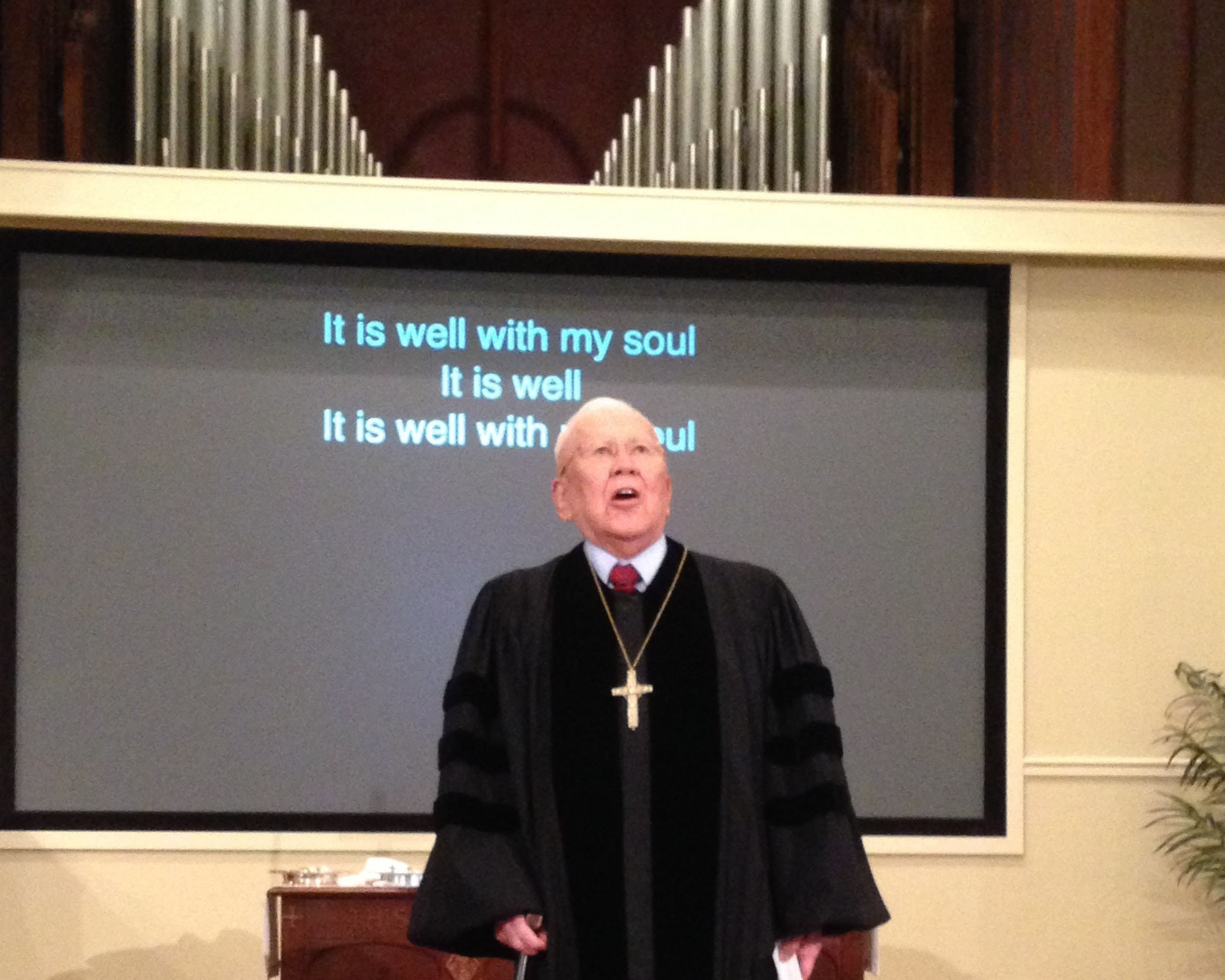 "Rev. Dr. Henry Fawcett singing ""It Is Well with My Soul."""