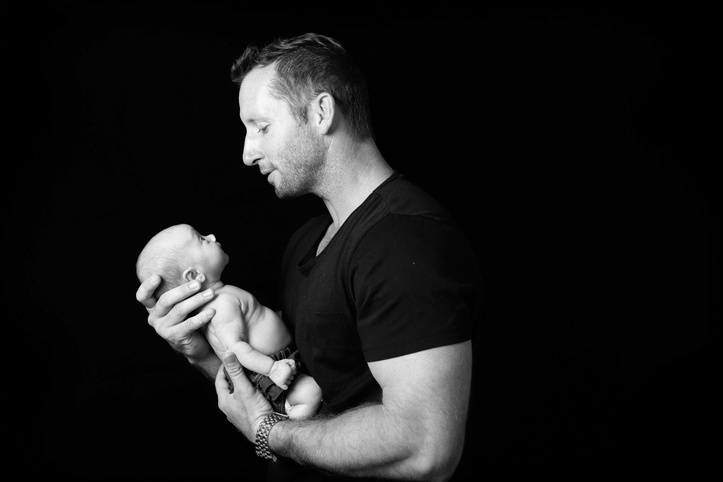 dad with newborn baby
