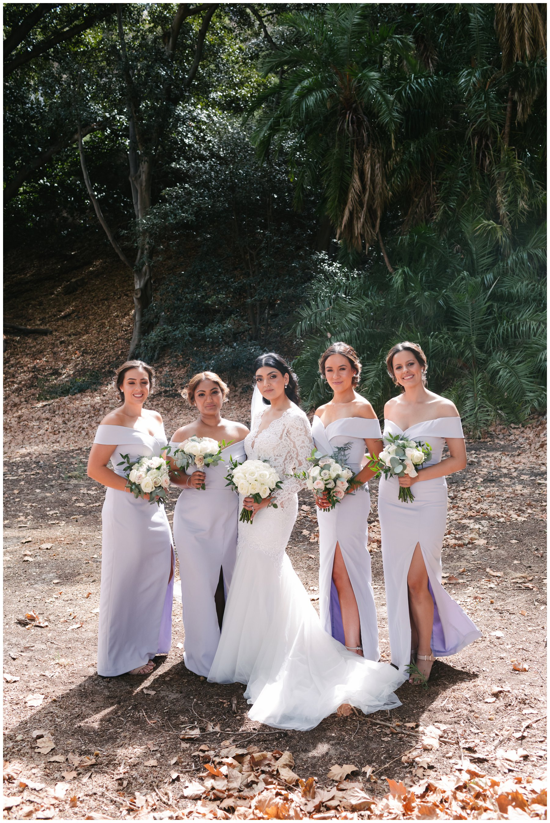 bridesmaids in lilac dresses with white roses