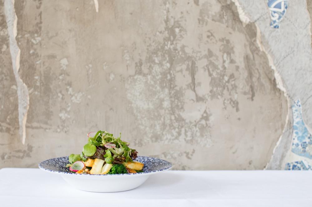 Six Storeys interior, a bowl of interesting salad