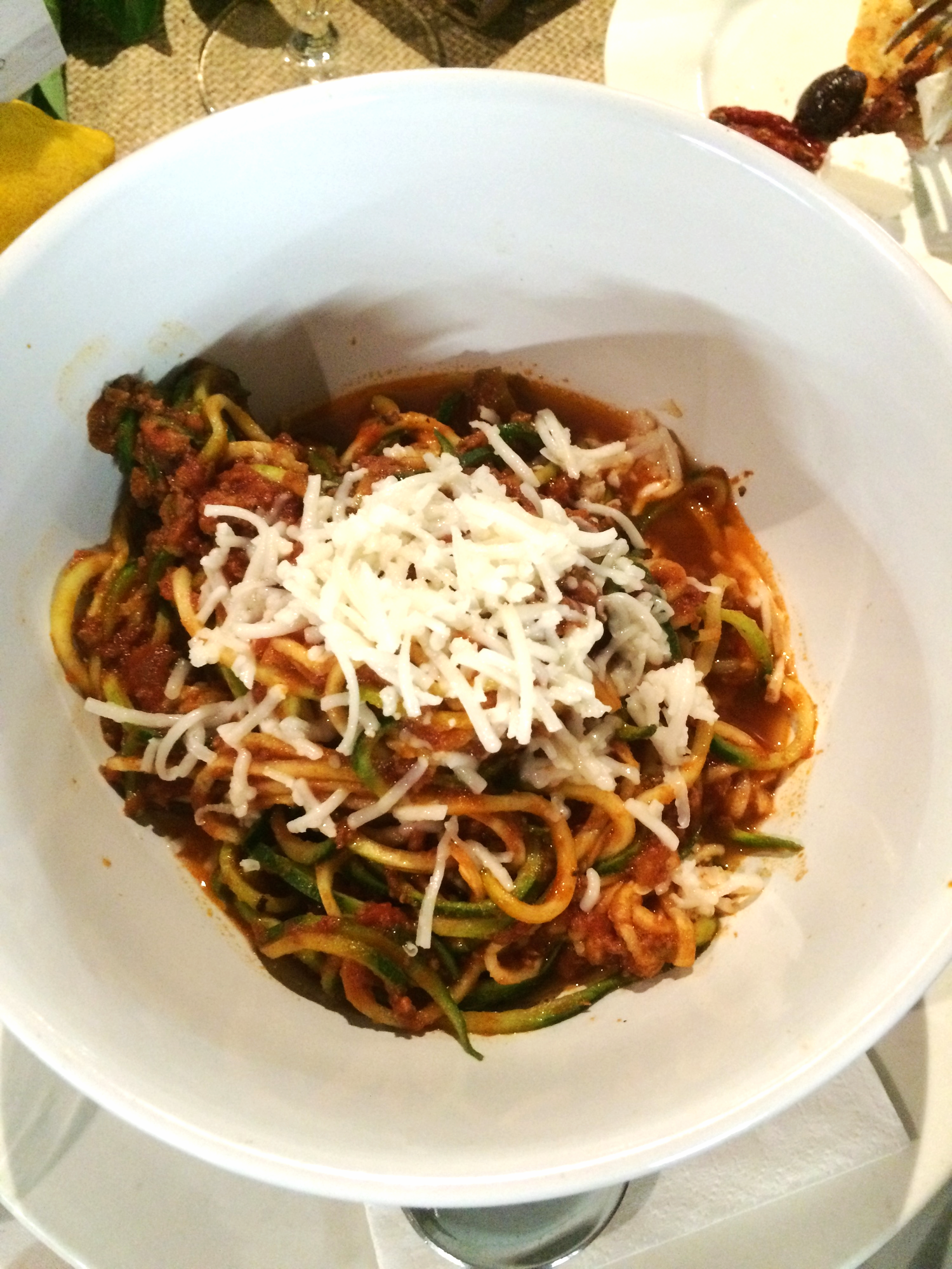 Spaghetti Bolognese with Zucchini pasta, topped with goats cheese