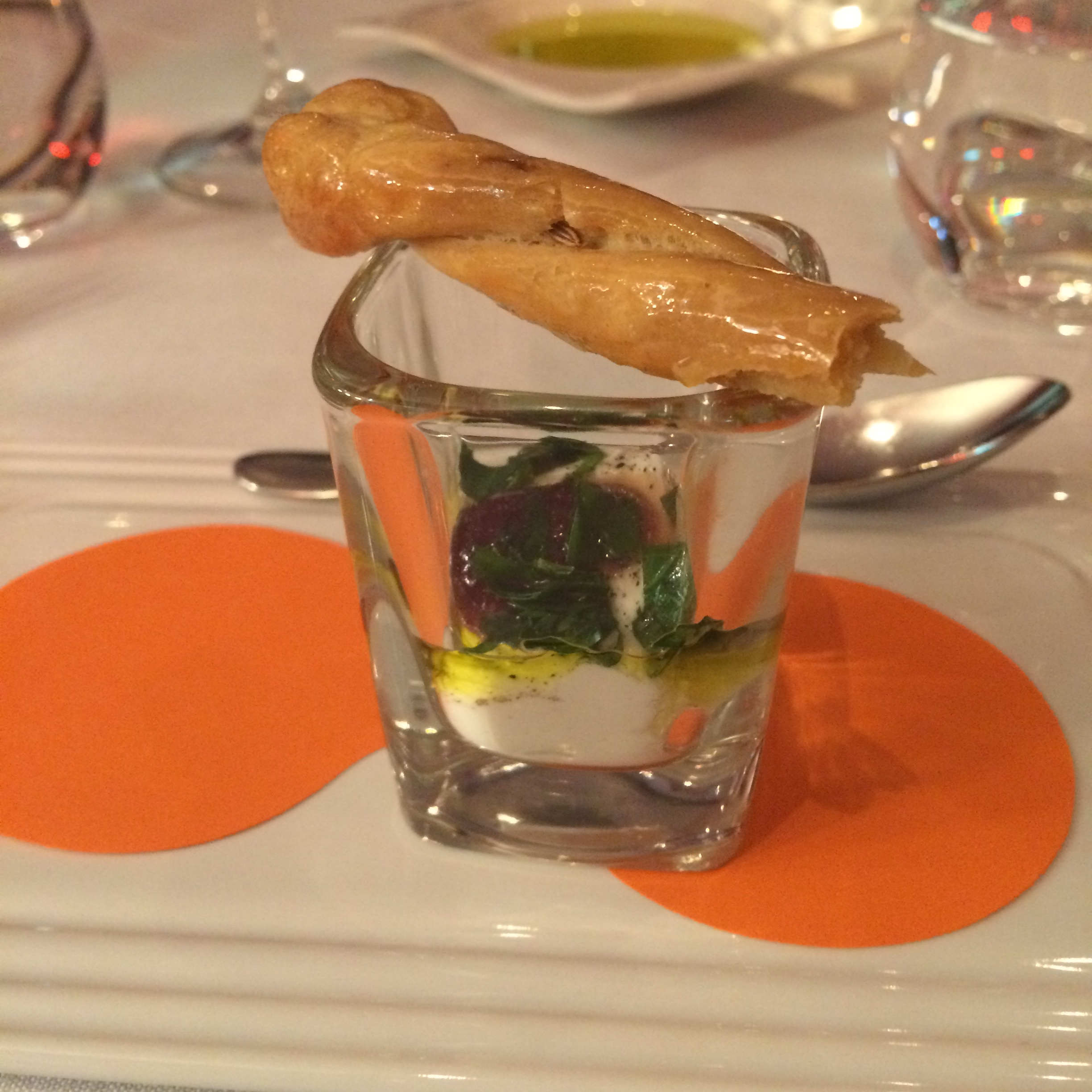 Goats cheese with quince paste and truffle oil and basil,served with a warm crostini stick