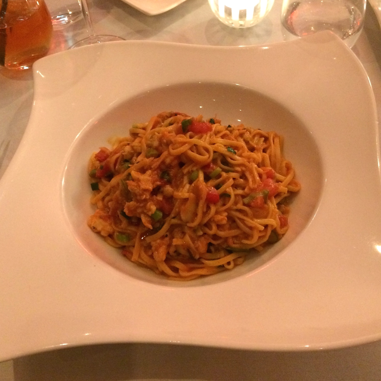 Saffron Chittare Pasta with SA Blue Swimmer Crab andNapolitana and Shellfish Sauce.