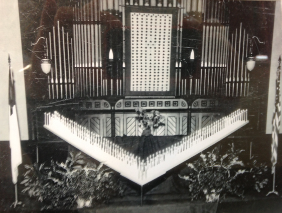 Façade of the Pilcher pipe organ in use at First Baptist from 1887 until 1949. Photo taken on Christmas Eve 1944 during a candlelight service for men and women serving in the military.