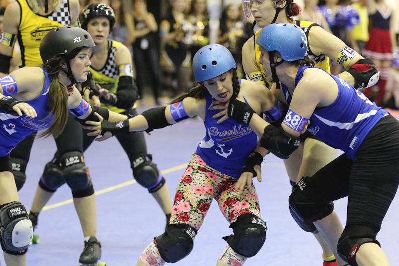 Brooklyn MVP Lady Fingers (middle) slows down Bronx jammer Legs//Cité with help from Bombshells BlueJ (left) and Sexy Slaydie. Photo by David Dyte.