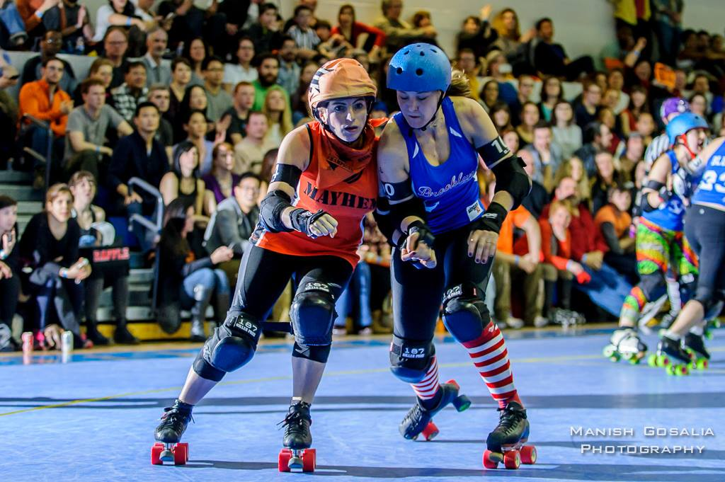 Manhattan jammer J-Rod Maven edges past Brooklyn blocker B'Zerk on her way to becoming her team's MVP for the game. Photo by Manish Gosalia.