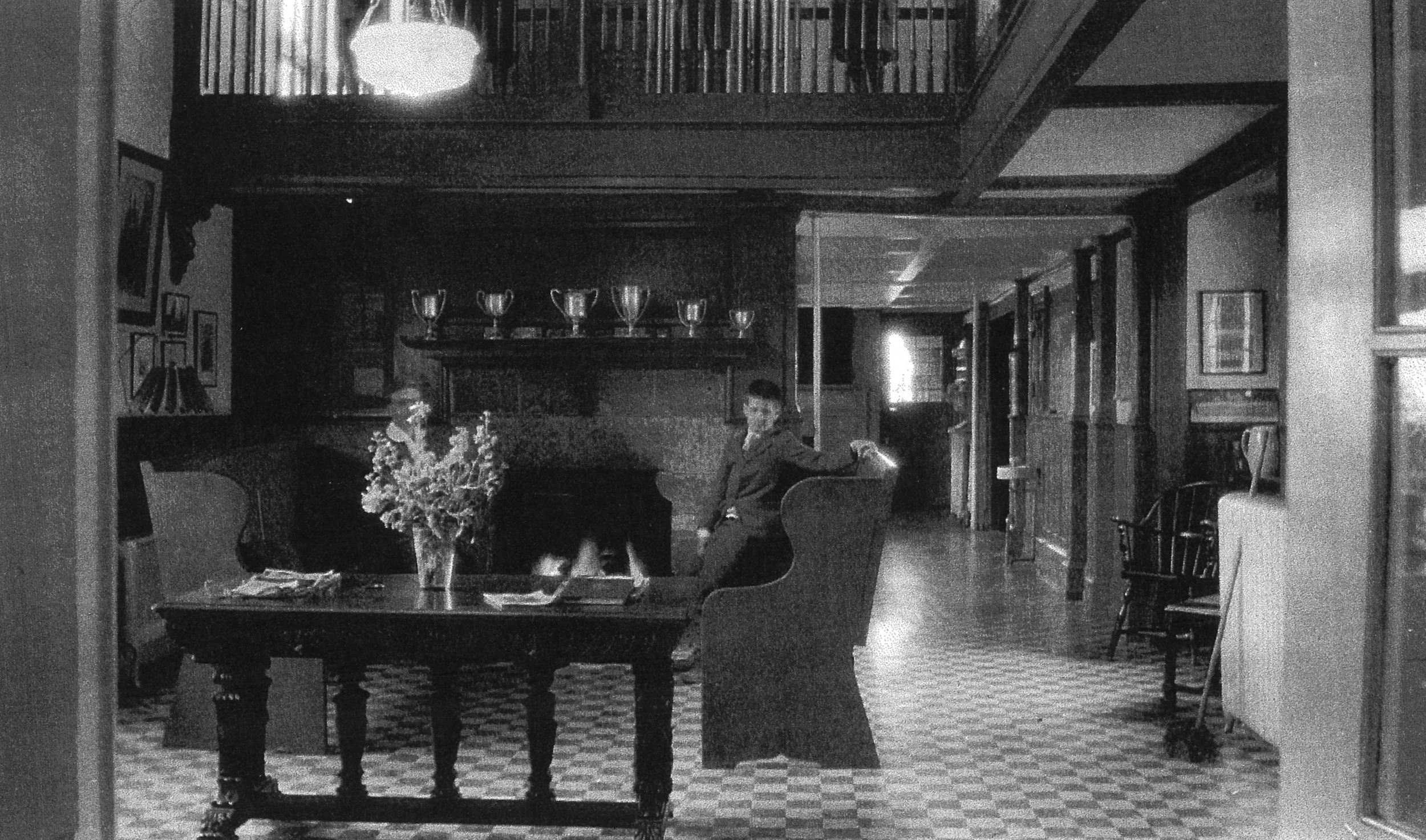 The Harrison family Library became a lounge for the new Rectory School, after 1926.  Note the white pipe column in all three photos: here it holds up the old library balcony,