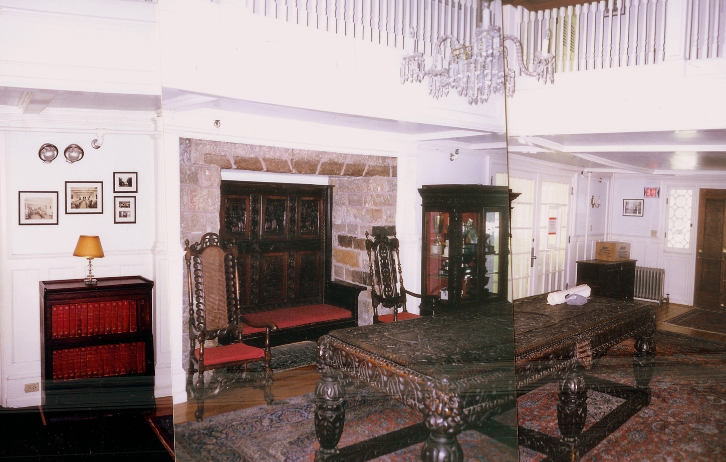 The entry hall before, opened up by Harrison. The room came to be occupied by outsized furniture, including a bench inside the fireplace, that detracted from a residential atmosphere.