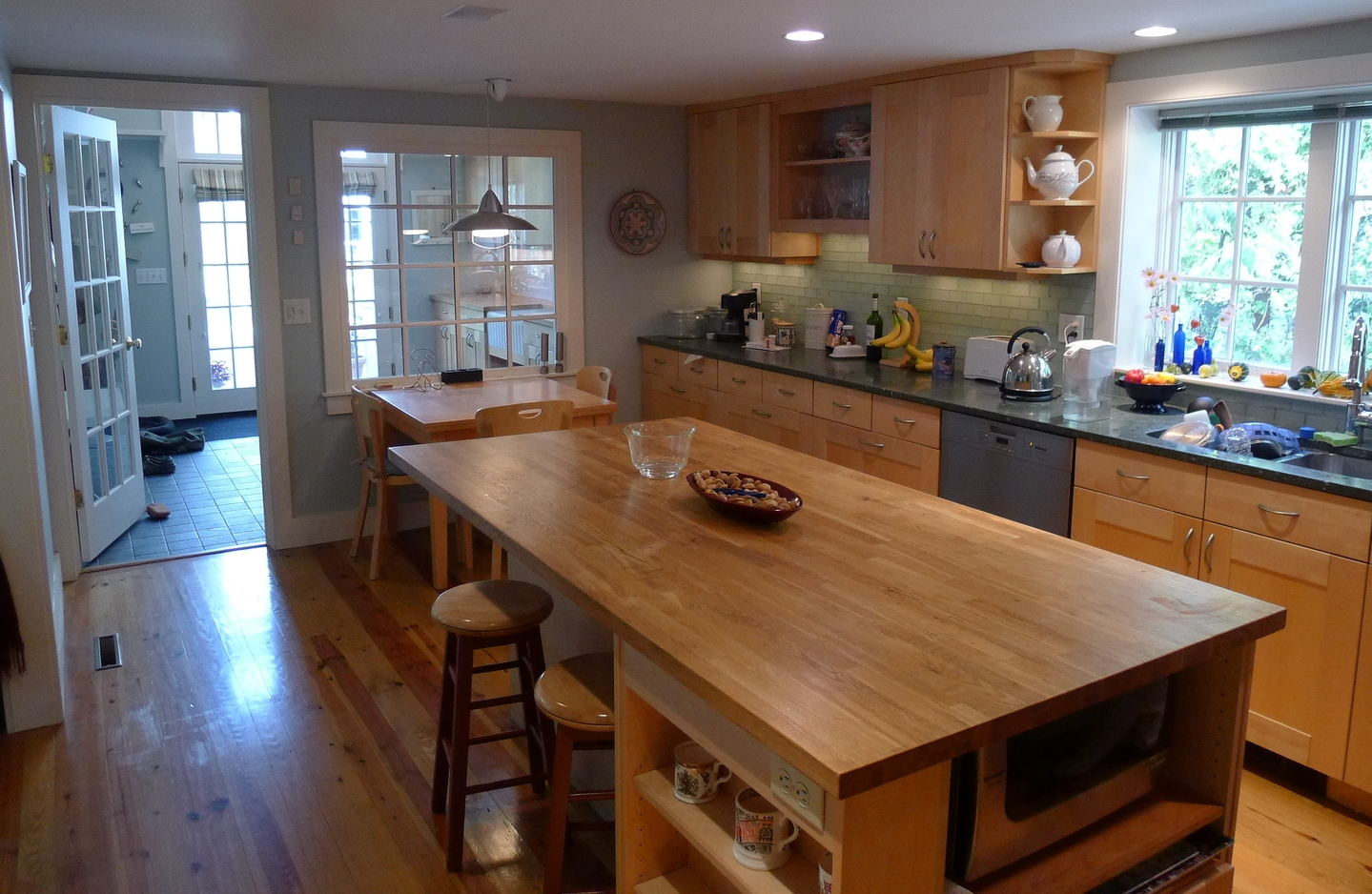 The new kitchen island and cabinets, with new Garden Room beyond.